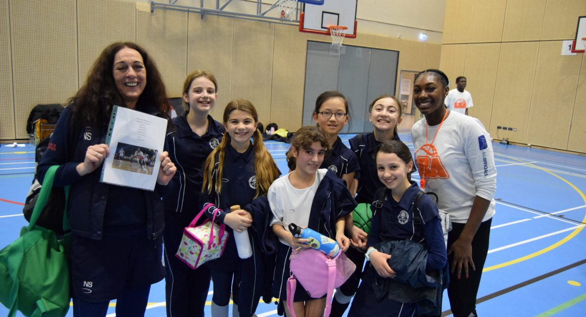 The girls from Queen's College Preparatory School with Coach Melita.