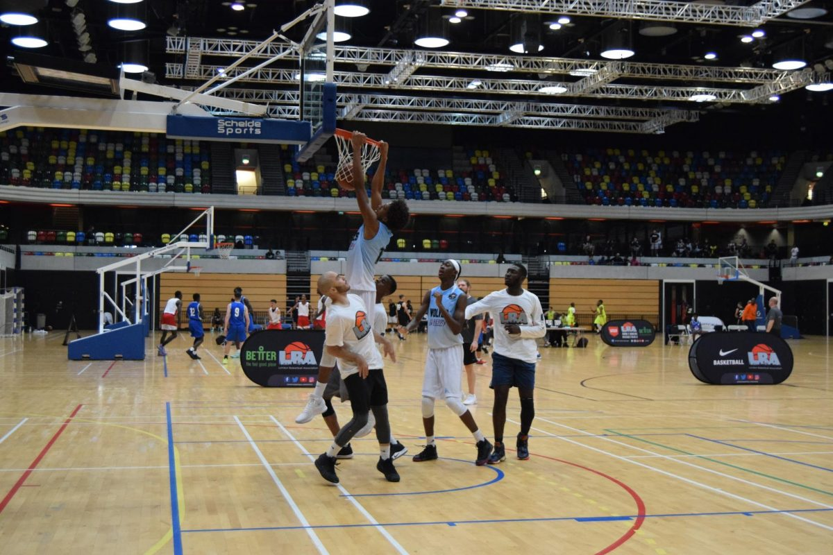 A player dunking over 4 other players.