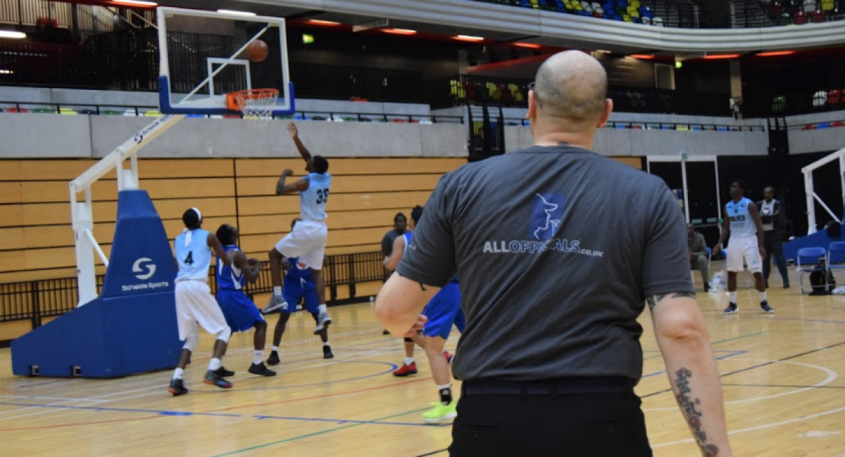 An official wearing an AllOfficials t-shirt while officiating a game.